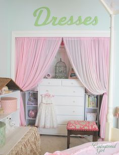 Beautiful closet conversion...Fancy's closet.  Hang clothes inside of changing table and remove all rods in the closet.  Insert changing table and small organizers beside it.  Add curtain and viola!  More space--SD