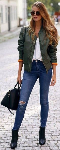 32a32670319 Hunter green jacket over white top and blue jeans with black boots. Green  Bomber Jacket