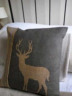 Love this handmade cushion from etsy to complement the vinyl wall sticker and the sofa. hand printed rustic blues stag cushion cover #HarveysChristmas (http://uk.pinterest.com/harveyshq/)