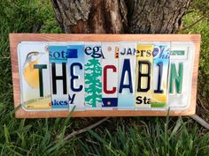 Signs Made From License Plates | The Cabin sign made from used recycled license plates