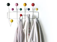 Eames Hang-It-All. Designers: Charles and Ray Eames. With their Hang-It-All, Charles and Ray Eames elevated the everyday coat rack into something inventive and fun