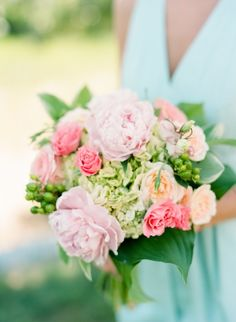 The prettiest ranunculus, hydrangea and peony bouquet: http://www.stylemepretty.com/north-carolina-weddings/belhaven/2015/08/31/coastal-elegance-inspired-wedding-in-north-carolina/ | Photography: Faith Teasley - http://faithteasley.com/