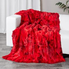 c130887745 This scarlet rabbit fur blanket throw is made with authenic rabbit fur pelts.  Features