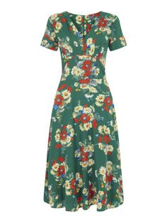 Beautiful green floral vintage inspired dress with colourful red and cream and blue flowers all over, This dress is simply beautiful with its stunning wrap front  detail, The beautiful wrap style waist creates a beautiful silhouette, from office to night out this vintage inspired dress is a perfect little addition to your spring/summer wardrobe.