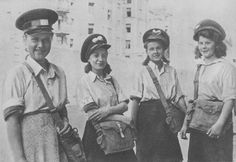 """Girl-guide postmen of the """"Gray Ranks"""" during the Warsaw Uprising, 1944. """"Gray Ranks"""" was a codename for the underground paramilitary Polish Scouting Association during World War II."""