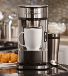 Scoop your favorite ground coffee, Fill with water, Brew  It's actually that simple!  - Single Serve Coffee Maker Review
