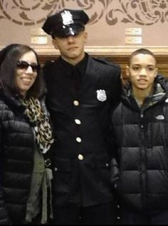 """Officer Santiago is seen with family in a Facebook photo. He died in the Line of Duty. Lured to the Drug Store by a convicted Drug Dealer for the intended purpose of """"killing a Cop"""". Rest In Peace Officer Santiago."""