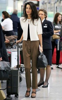 Arriving in Style from Amal Clooney's Best Looks Mrs. Clooney looks prim and polished waiting in line at the airport.