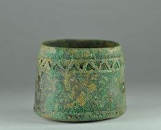 Luristan bronze cup, 1st millenium B.C. Luristan Bactrian bronze cup with banded decoration on the top and on the base, 5 cm high. Private collection