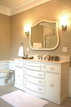 I love this bathroom cabinet with a row of wide drawers under the sink. Unfortunately, no link.