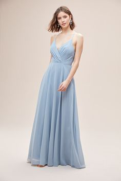 This long chiffon bridesmaid dress gives an aura of dreamy romance from the softly pleated, plunging-V neckline to the billowy, floating full circle skirt. The faux-wrap style bodice is matched with adjustable spaghetti straps to ensure the perfect fit. Available in Sydney, Melbourne & Online.  Cute Prom Dresses, Bridesmaid Dresses, Formal Dresses, Wedding Dresses, Bridesmaids, Full Circle Skirts, Brisbane, Melbourne, Sydney