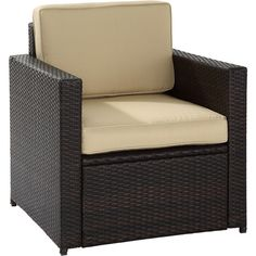 Complete your patio ensemble or lounge around the firepit with this wicker-inspired arm chair, showcasing a track design and rich brown finish.