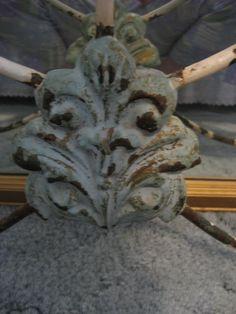 an upclose picture of my fleur de lis antique iron bed