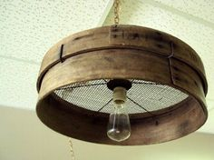 26 Breathtaking DIY Vintage Decor Ideas - Old grain sieve repurposed into a primitive chandelier.