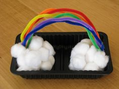 Cute rainbow made of pipe cleaner and cotton balls