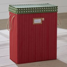 """Gift yourself the convenience of organization this holiday season! Our gift wrap storage bag features separate storage compartments that file away tissue paper and gift bags, while a hanging accessory pouch holds ribbons, tape, scissors and more. Paired with our 12-roll wrapping paper holder, you'll breeze through wrapping sessions in no time.  Dimensions: 18""""W x 8""""D x 22""""H Braided carry handles Durable PVC pressed fabric Spot clean Imported"""