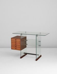 Gio Ponti  Desk, from the Vetrocoke offices, Milan 1939 Vitrex glass, sycamore-veneered wood, walnut, nickel-plated metal, rubber. 68.9 x 102.9 x 41.6 cm