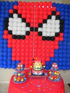 Spider man in balloons as backdrop.