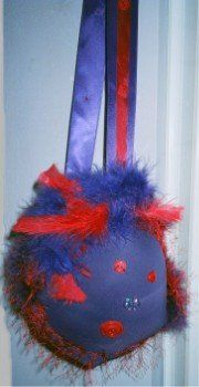 Red Hat Society purse  made out of a large bra.  LOL