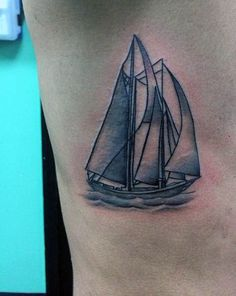 Small Ribs Mens Sailboat At Sea Tattoo