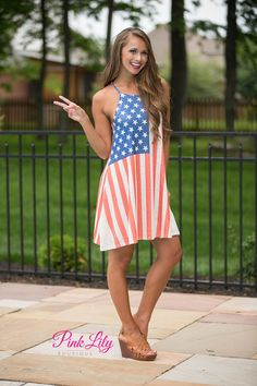 Show your American pride all summer long in this halter-style dress! Featuring a vintage American Flag style pattern, we love the bold stars and stripes! This soft and slightly textured dress will stay comfortable all day long, even on the warmest of summer days. It also has a racerback style and is sleeveless.
