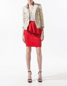 Zara -  Loving the tough jacket in a feminine color with bright peplum.