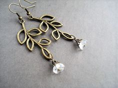 White Flower Earrings Bridesmaid Gift Vintage Style Long Earrings Floral Jewelry Leaf Earrings Woodland Jewelry Bohemian Earrings Gift Idea  They are made with Czech glass flower beads embellished with antique brass filigree bead caps hanging from antique bronze long leaf branch connectors. The total length is 2.75 (7 cm) including antique bronze ear wires lead and nickel free.  My items are shipped in organza bags and padded envelopes to keep your shipping cost as low as possible. If you…