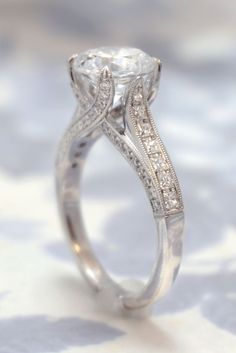 This classic diamond engagement ring features a round brilliant center with princess cut diamonds channel set down the sides and plenty more diamond accents throughout. Work with us to customize this Princess Cut Rings, Princess Cut Engagement Rings, Vintage Engagement Rings, Princess Wedding, Princess Cut Diamonds, Engagement Jewelry, Engagement Rings Channel Set, Round Cut Engagement Rings, Engagement Solitaire