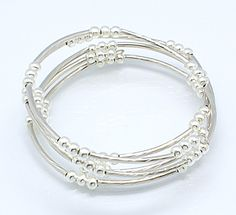 Silver memory wire bracelets with brass tube beads and iron spacer beads