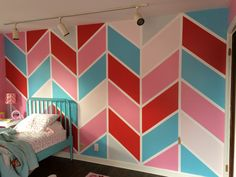 I did this custom chevron wall in my daughter's room using colors she picked out. Took two days and we love it!