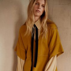 Off-white silk bow detail shirt from Chloé featuring a classic collar, long sleeves, a front button fastening, pleated details and button cuffs.