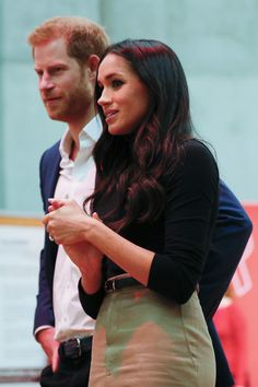 Prince Harry Meghan Markle Photos - Prince Harry and his fiancee US actress Meghan Markle tour the Terrence Higgins Trust World AIDS Day charity fair at Nottingham Contemporary, as part of their first set of official public engagements together, on December 1, 2017 in Nottingham, England. Prince Harry and Meghan Markle announced their engagement on Monday 27th November 2017 and will marry at St George's Chapel, Windsor in May 2018. - Prince Harry & Meghan Markle Visit Nottingham