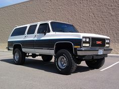 1990 Chevy (or GMC) Suburban. This thing was a bus! SUPER comfy! Total gas hog! I owned this; same paint except for custom pin striping.  So many great times with my hubby and 4 boys!!!!