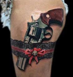 Super Realistic Gun in Garter Tattoo