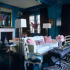 The accessories in this dark blue room brighten everything up