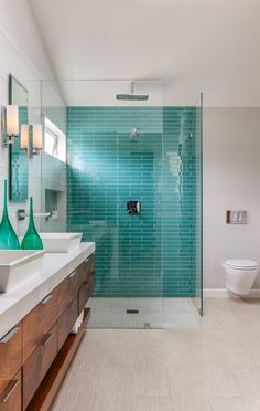 coastal bathroom - aqua blue subway tiles. A little beachy but still very modern.