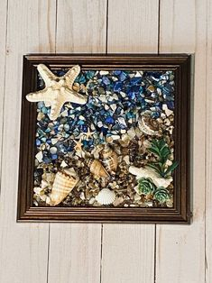 """8""""x 8"""" Beach Glass Wall and/or Window Art/Seashell Art/Resin Art/Unique Coastal Decor/Beach House Decor/Sun Catcher/Great Christmas Gift  Handmade in South Carolina with high quality materials (seashells, crushed shells, succulents, sand pebbles, knobby starfish) and secured with care. The design is"""