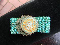 Antique button on hand sewn cuff