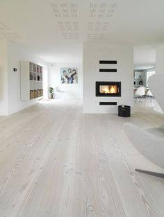 oak flooring Im hoping my white oak wood floors can be made to look something like this.more cool and driftwood-like than warm, honey tones. Living Room Wood Floor, Living Room White, Living Room Flooring, White Rooms, White Walls, Living Rooms, Apartment Living, White Wooden Floor, White Oak Wood