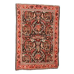 Vintage Shirvan wool rug.  Product: RugConstruction Material: WoolColor: MultiDimensions: 66 x 44Note: Due to the vintage nature of this product, some wear and tear is to be expected. Products may show signs of brand marks, scrapes or other blemishes. Please be aware that actual colors may vary from those shown on your screen. Accent rugs may also not show the entire pattern that the corresponding area rugs have.Cleaning and Care: Wipe with a damp cloth