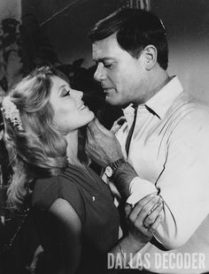 """Afton (Audrey Landers) tempts J.R. (Larry Hagman) in this 1981 publicity shot from """"End of the Road, Part 1,"""" a fourth-season """"Dallas"""" episode. Relive more memories at DallasDecoder.com."""