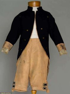 """Young boy's formal suit, c1776; Cutaway jacket of navy wool with brass buttons, lace cuff flounces, pink silk and wool blend flannel-lined knee britches, W 22"""", Jacket CBL 22.5"""""""