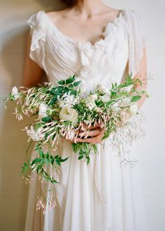 This wide and wispy bridal bouquet beautifully complements her lovely dress...