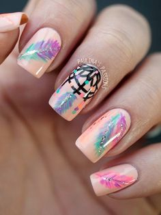 Cute and tribal themed feathers nail art design. Use pastel colors to create the sweet effect of this nail art. You can also add a black polish to define the design of the dream catcher painted on top.
