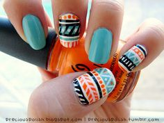 Love these nails. LOVE. I need to get myself some colors like that so I can do something similar. So desert and tribal.