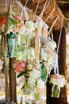 Hanging jars with flowers