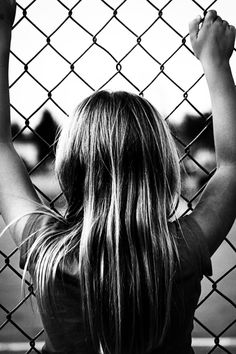 Watching baseball from the other side of the fence. Baseball girl born and raised! Love this shot!