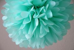 Aqua Tissue Paper Pom .. Wedding Decor / Bridal Shower / Baby Shower / Tiffany Blue / Party Decoration. $4,00, via Etsy.