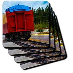 A red caboose of a train sitting on the tracks in Yellowstone Coaster
