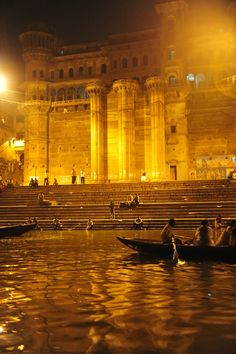 Varanasi Ghats - sunrise boat ride, before the sun rose, floating candles and petals in the water.